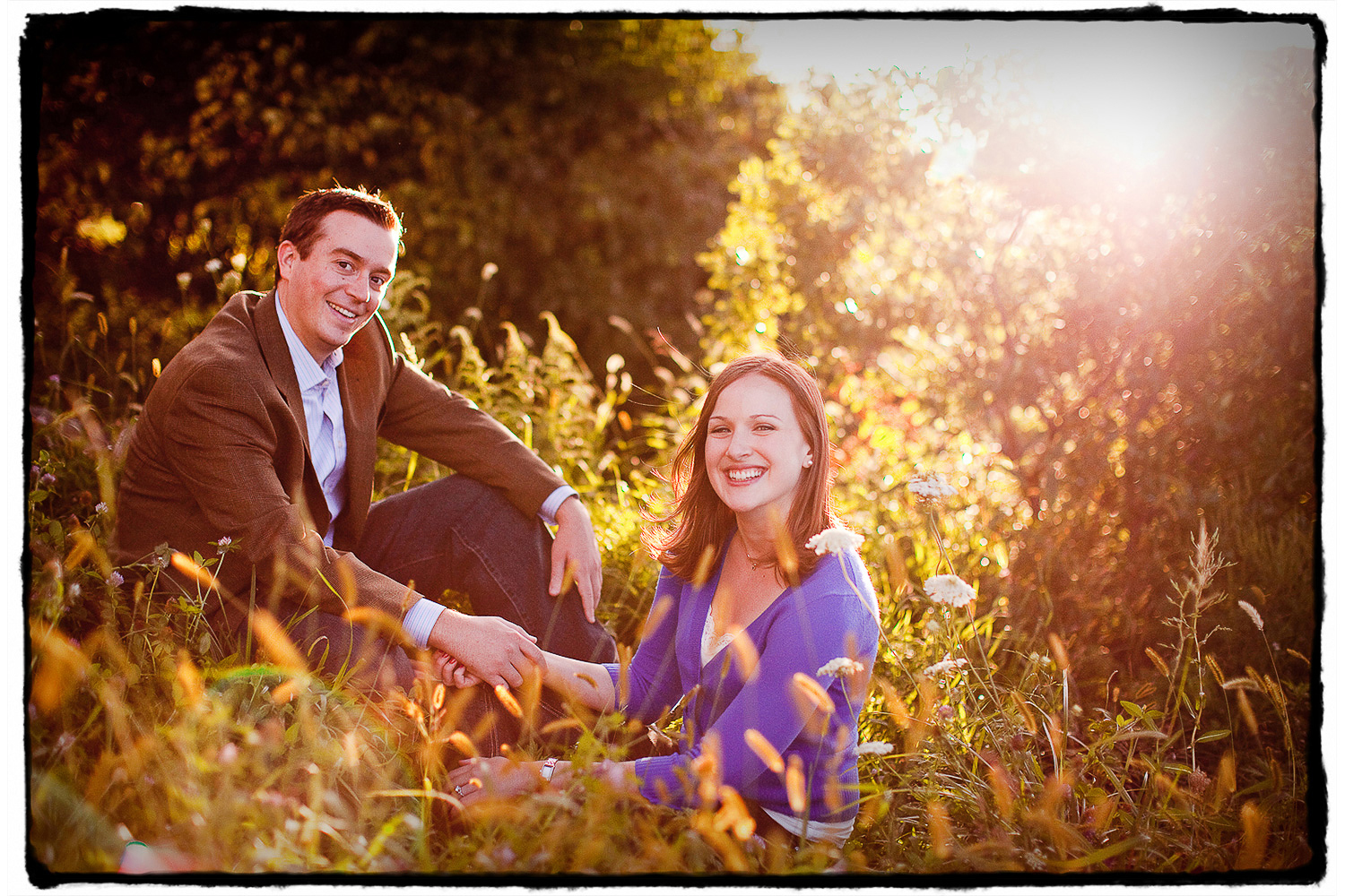 Engagement Portraits: Amy & Mike in the grass at Brooklyn Bridge Park.