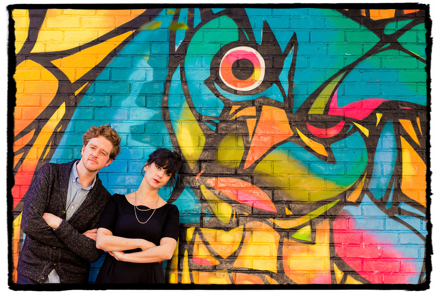 Engagement Portraits: Alli & Parker make funny faces with the street art in DUMBO.