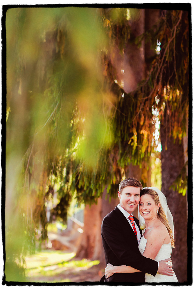 "Noelle and Tim moments after sharing their ""first look"" under a line of incredible trees at Highlands Country Club."