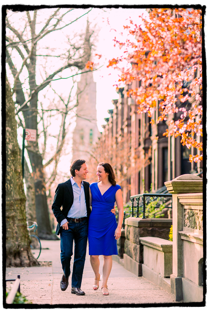 Engagement Portraits: Laura & Axuve walk along a treelined street in Park Slope.