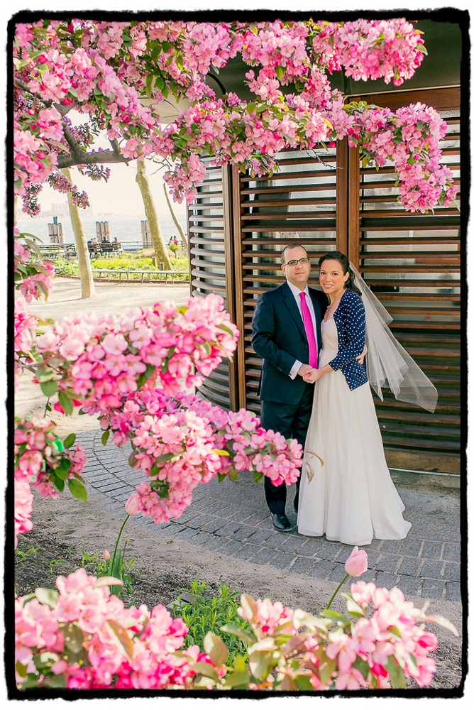 When I saw these gorgeous pink cherry blossoms I knew I had to frame a portrait of the couple, they matched the groom's tie so beautifully.