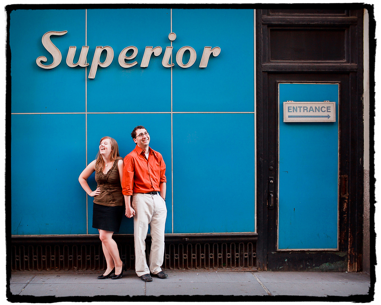 Engagement Portraits: Katie & Jason under some auspicious signage in the Flatiron area of Manhattan.