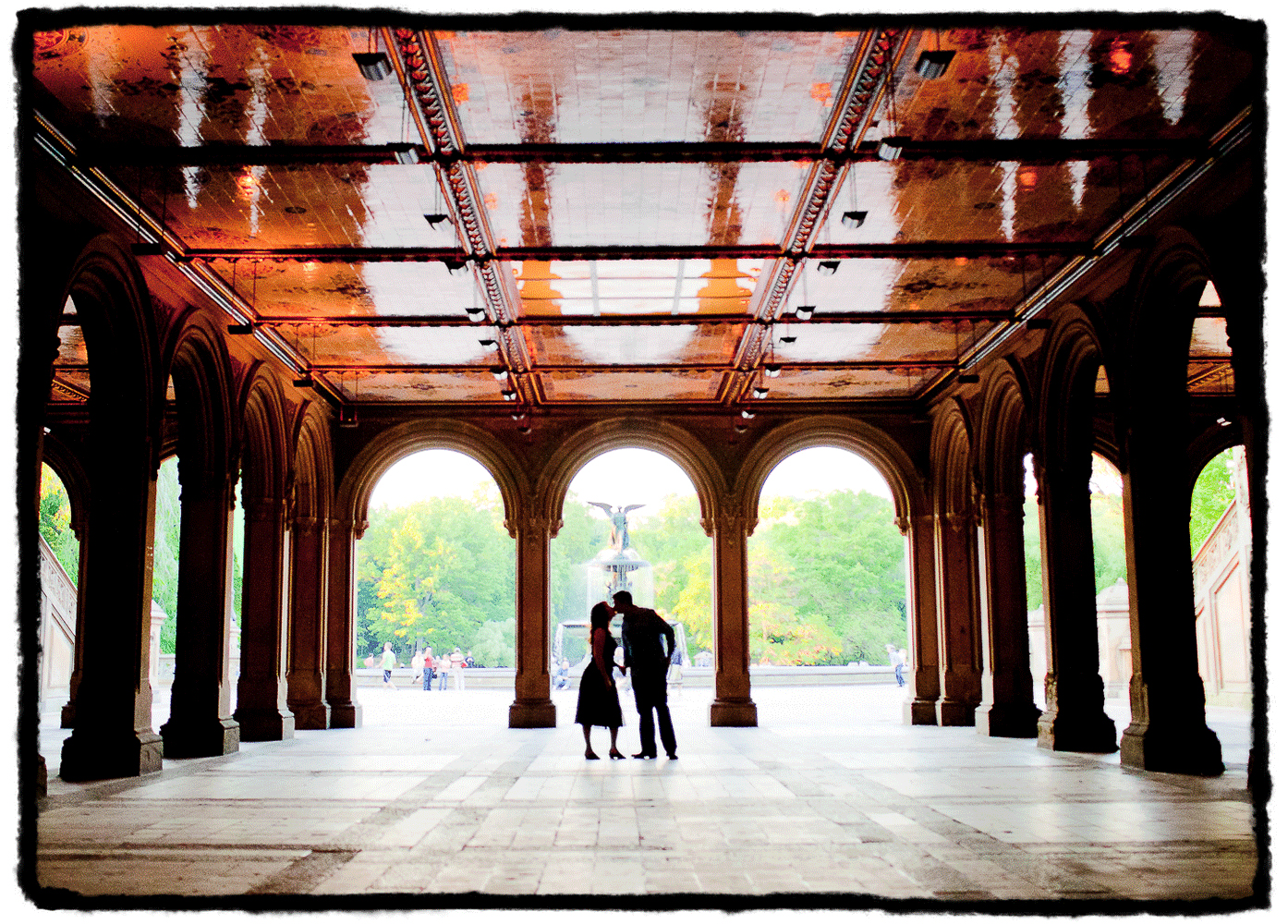 Engagement Portrait: Amy & Jon share a kiss by Bethesda Fountain in New York's Central Park.