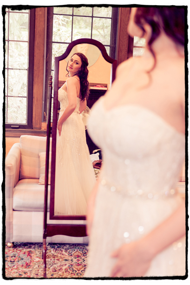 Michelle checks the final fit of her wedding dress in the mirror at Lyndhurst Mansion..