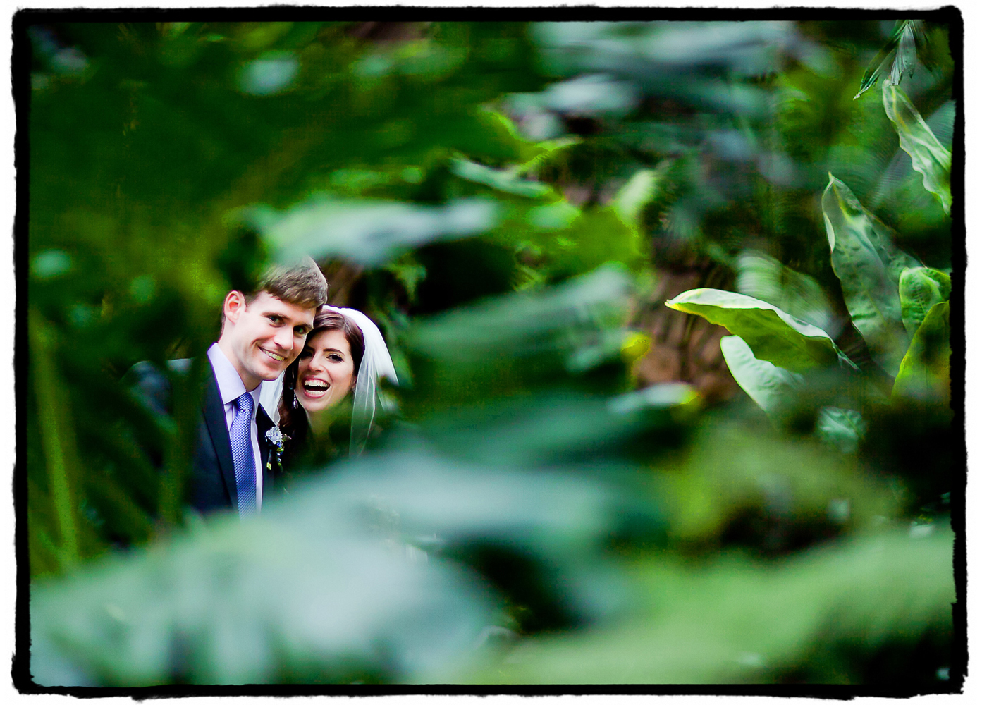I shot this portrait through the foliage at Brooklyn Botanic Garden. I love the bokeh framing them in foreground and background.