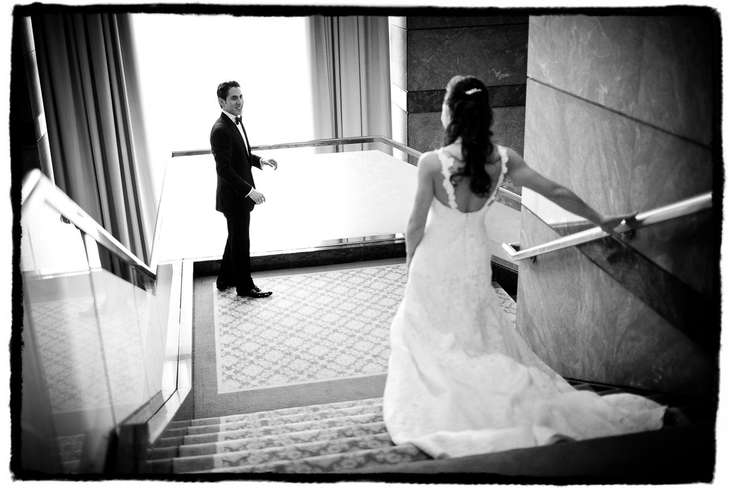 Aaron beholds his bride coming down the stairs at The Ritz-Carlton Battery Park.