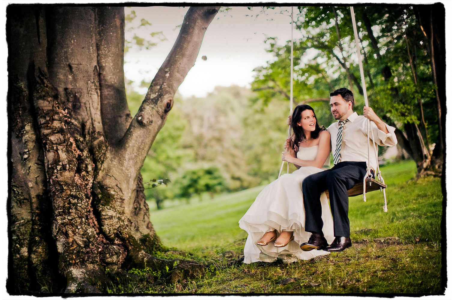 A couple takes time with me for some 'just married' shots of them enjoying the tree swing at Winthrop Estate.