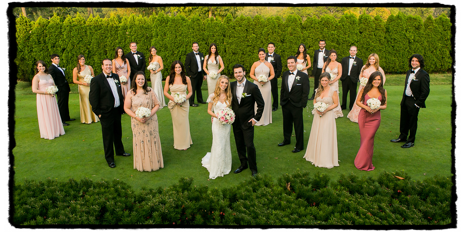 Jayme and Brad's black tie bridal party in shades of pink at Fresh Meadow Country Club.