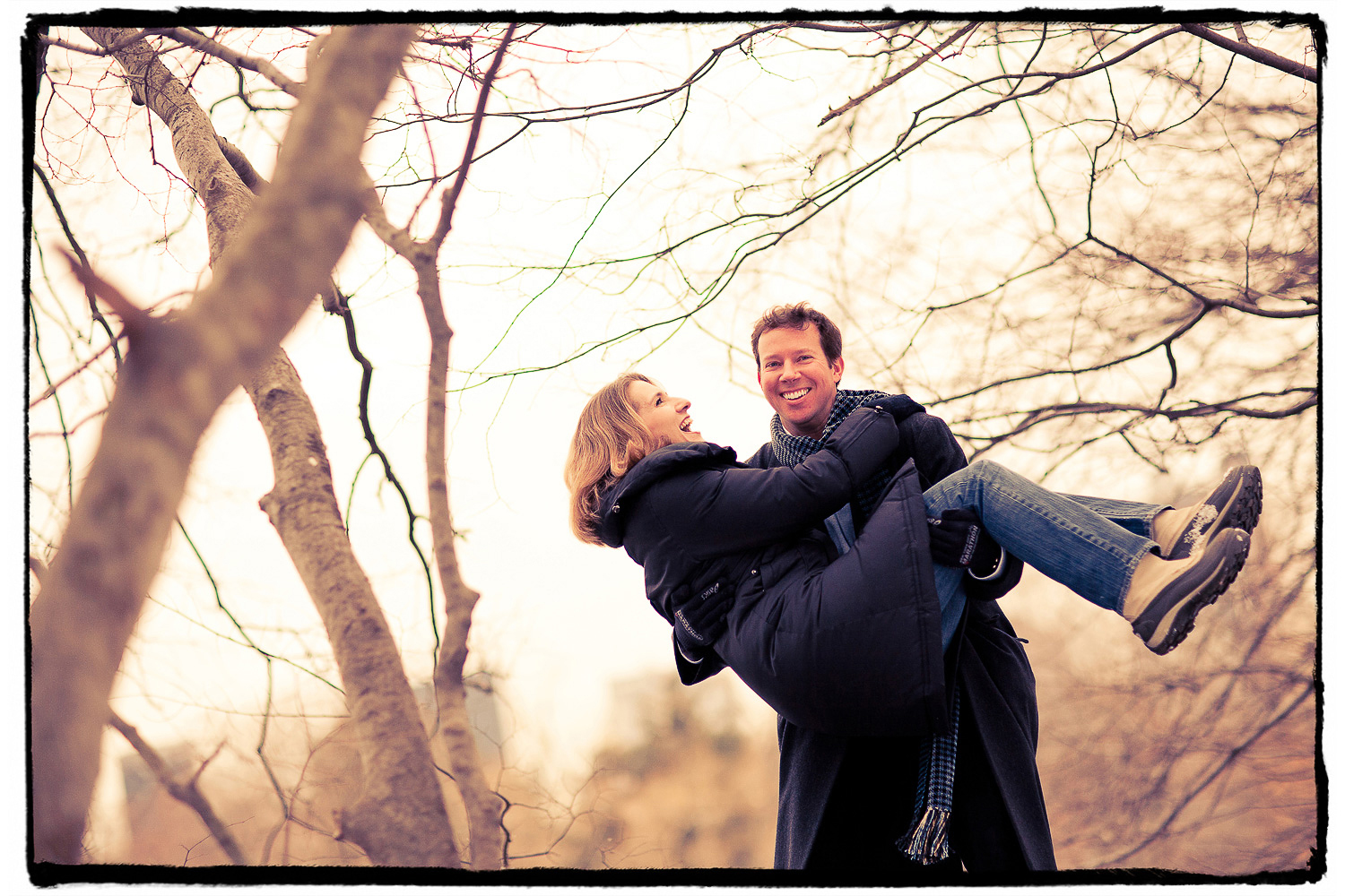 Engagement Portrait: Doug practices his threshold carrying in Central Park mid-winter.