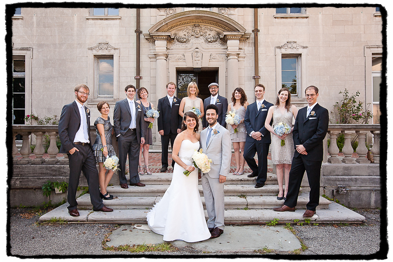 Tracey & Ben and their bridesmaids and groomsmen on the front stairs outside of Alder Manor in Westchester NY.