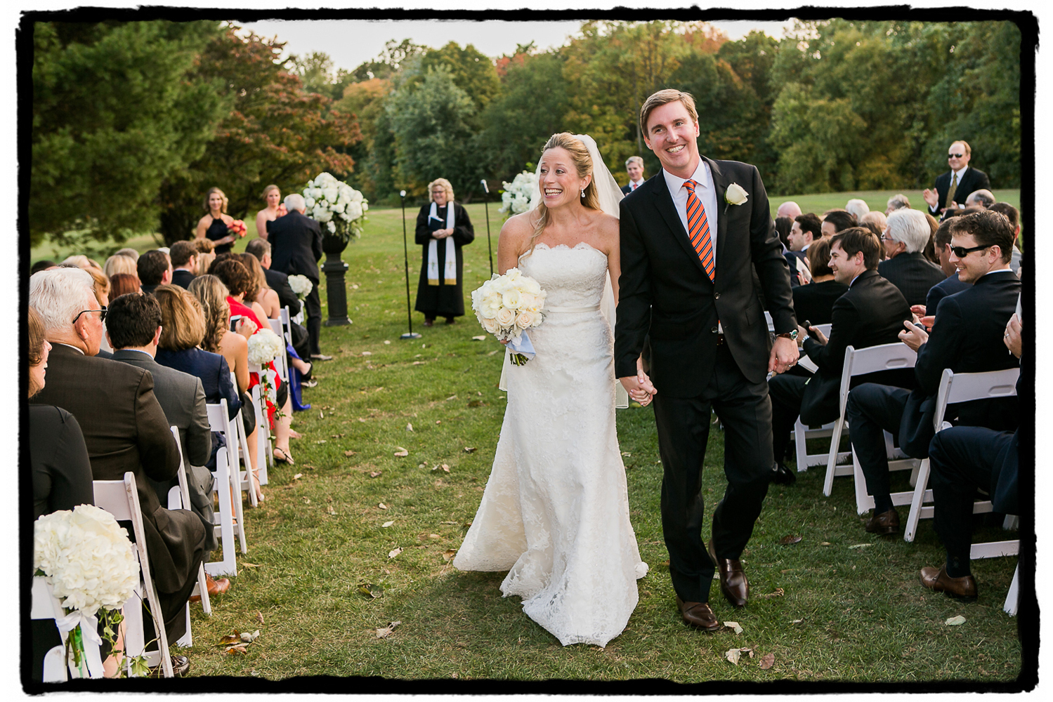 The smiles were contageous at Highlands Country Club as Noelle and Tim walked back down the aisle as husband and wife.