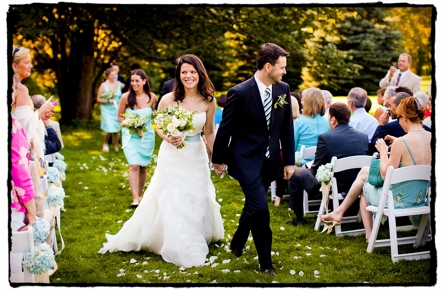 Luke and Anna walk back down the aisle after a sweet outdoor summer ceremony at The Winthrop Estate in western Massachusetts.