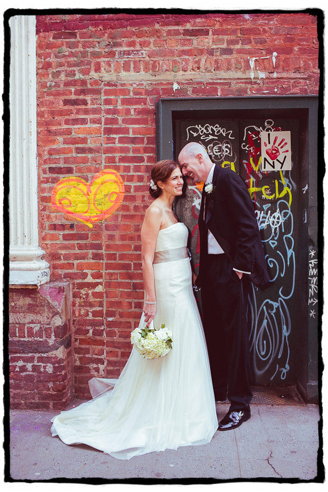 It brings me so much joy to find street art that can complement a couple's portrait-- this grafitti heart was perfect for a portrait in front of this SoHo doorway.