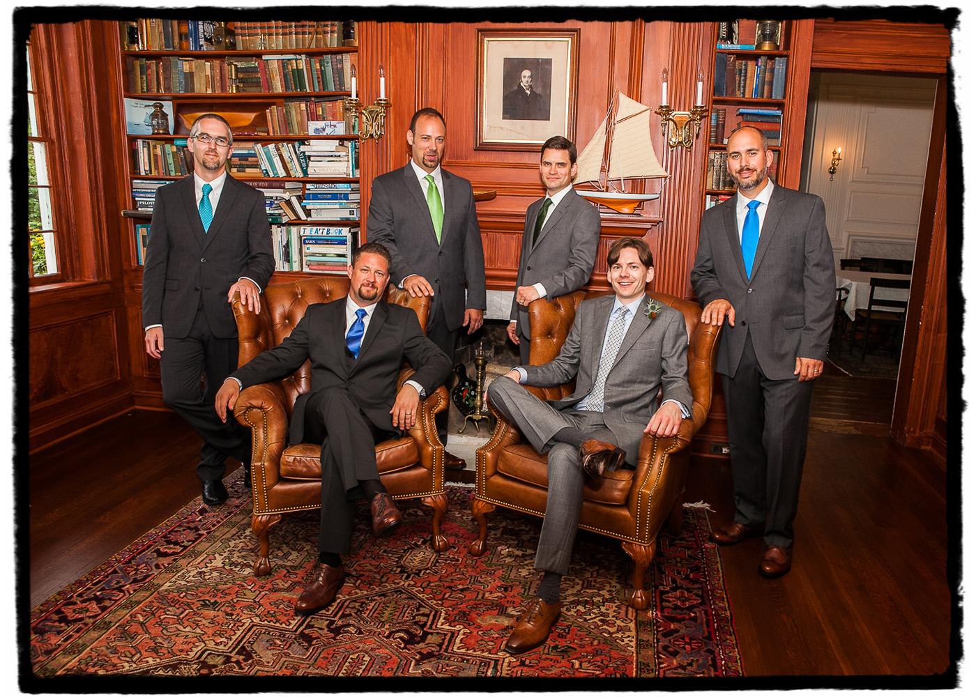 Dano and his groomsmen enjoy the handsome interior at this charming Inn by a lake.