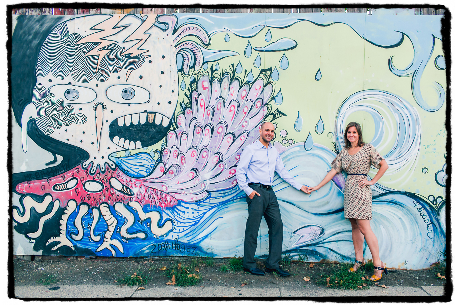Engagement Portrait: Laura & Joel show off the street art in their neighborhood of Red Hook, Brooklyn.