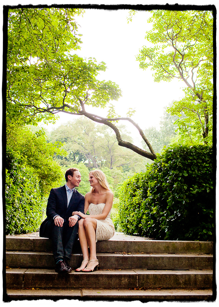 Engagement Portrait: Charlie & Kate sit on the steps in Central Park Conservancy Gardens.