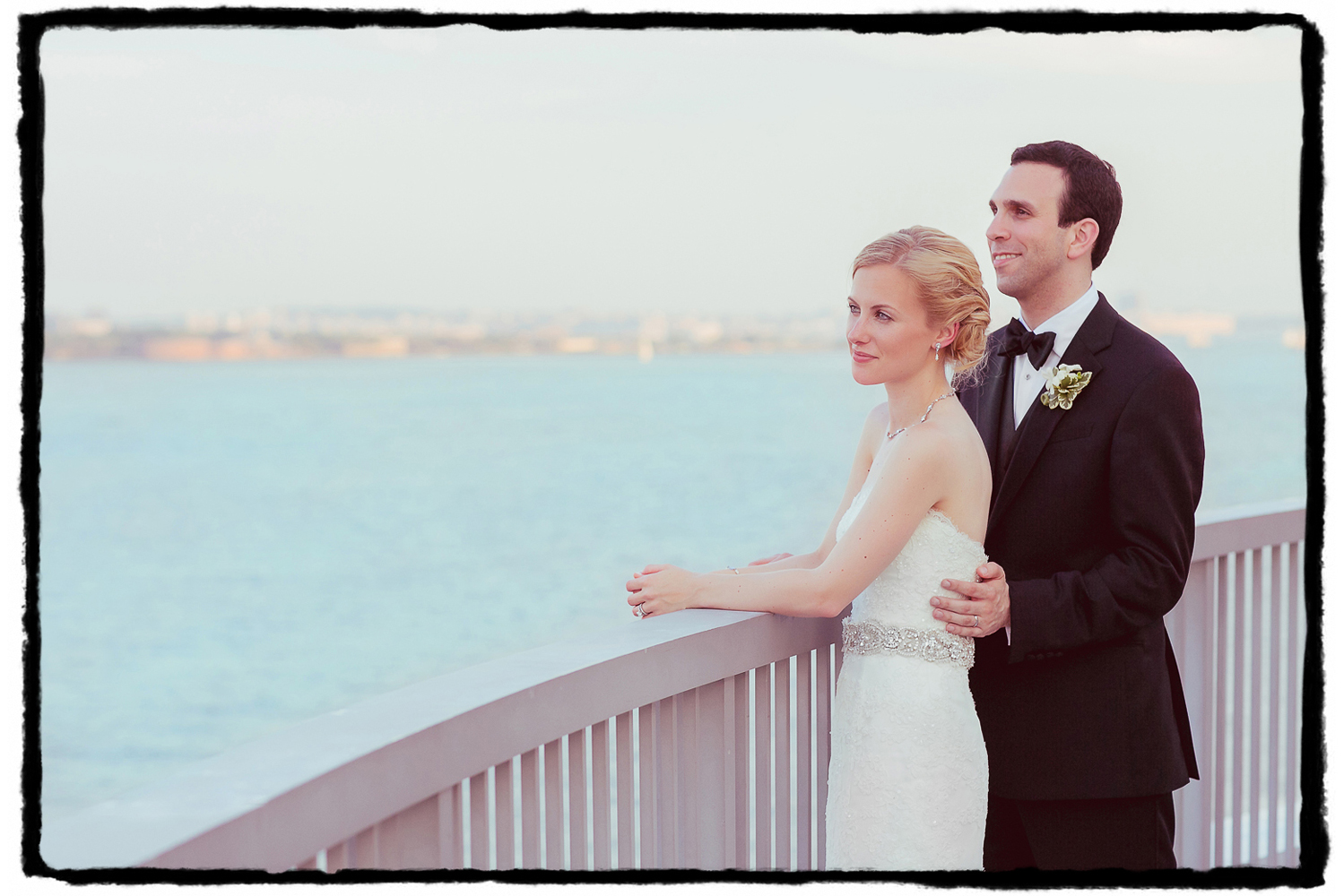 Gena and Josh share a quiet moment to enjoy the glittering NYC skyline across the river as the sun goes down at the Hyatt in Jersey City.
