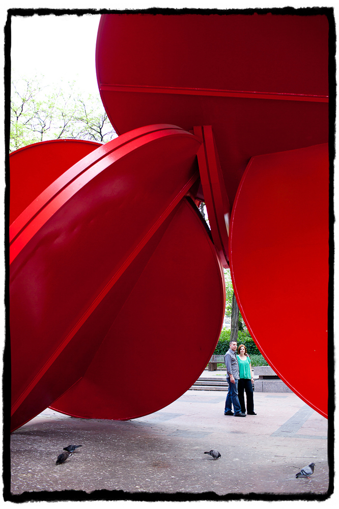 Engagement Portraits: Cheryl & Brian by a sculpture at City Hall.