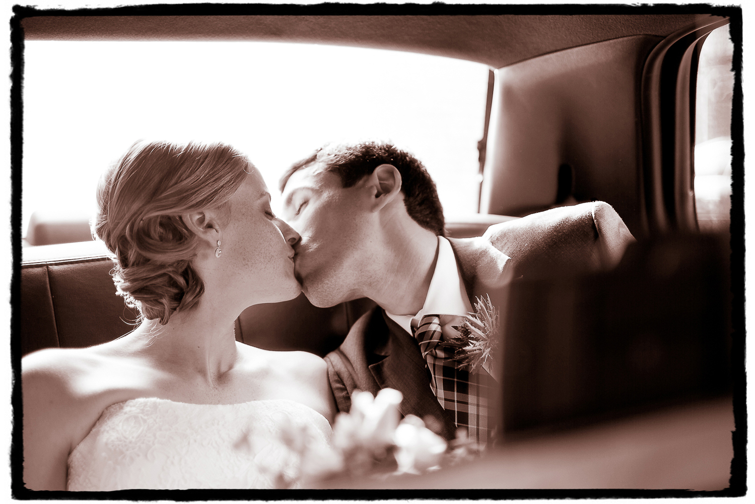 Seth and Jennifer sharing a moment in the back of our cab en route to Housing Works Bookstore in SoHo from the family and bridal party group shots we took by the Arch in Washington Square Park.