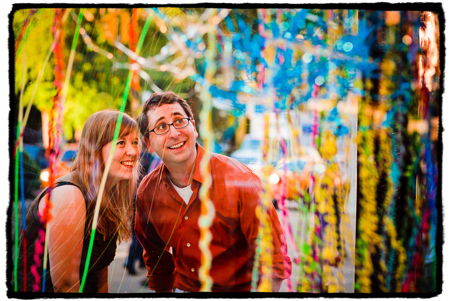Engagement Portraits: Katie & Jason check out the art installation in the Flatiron Building.