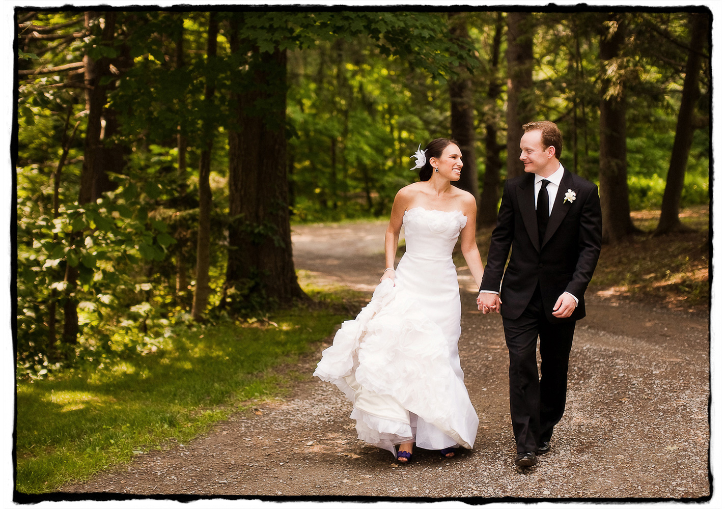 The grounds at Buttermilk Falls Inn are an incredible spot for a romantic stroll.  I loved how Michele's dress flounced as she walked with her husband-to-be.