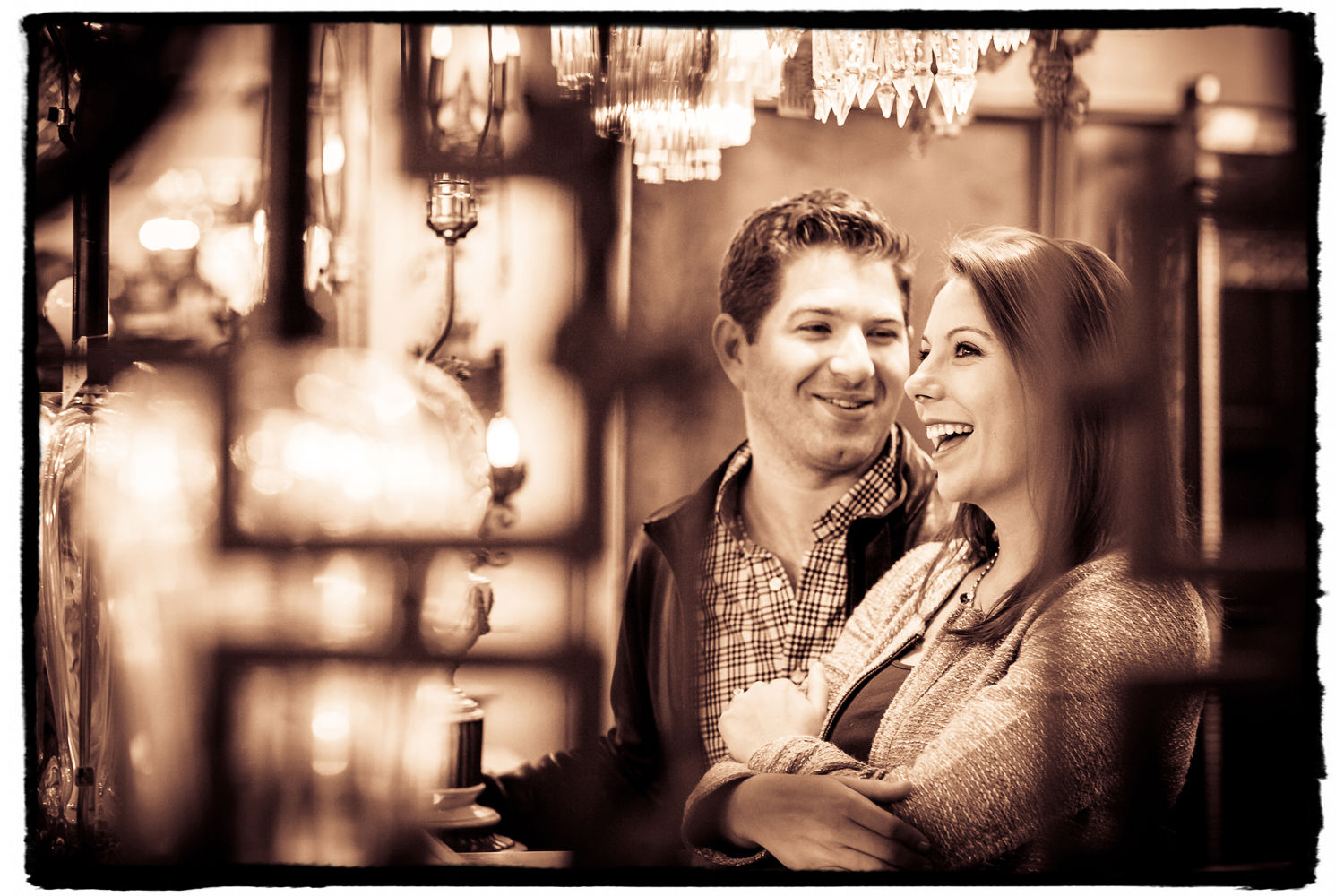 Engagement Portrait: Meghan & Terence check out the crystal chandeliers in the antique store across the street from their building.