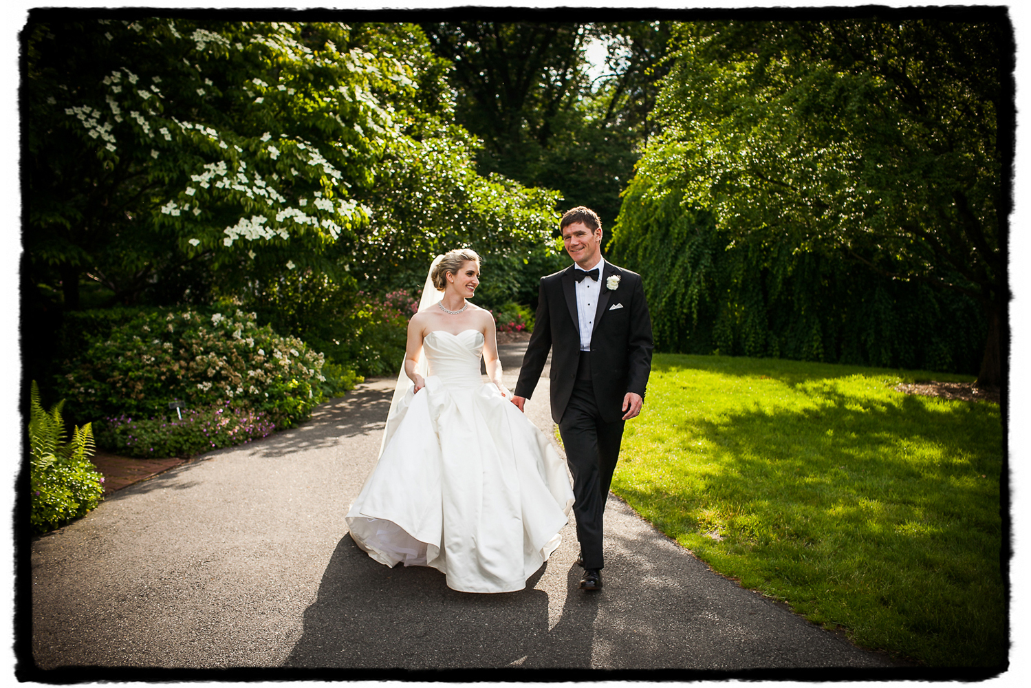 Sarah and Chris were picture perfect on their wedding day, shown here strolling through Freylinghuysen Arboretum.