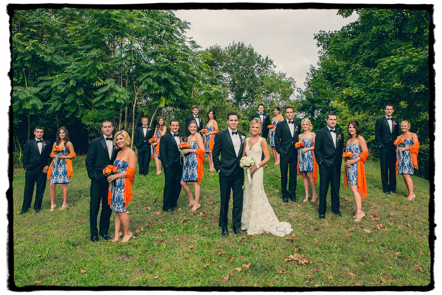 Patterned blue and orange paired with black tuxedos were the order of the day for Devin & Mike's wedding at Belle Haven Club in Greenwich, CT.