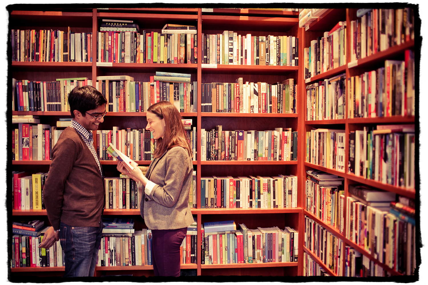 Engagement Portrait: Katie reads a passage to Sharmilan in their local bookstore in Chelsea.