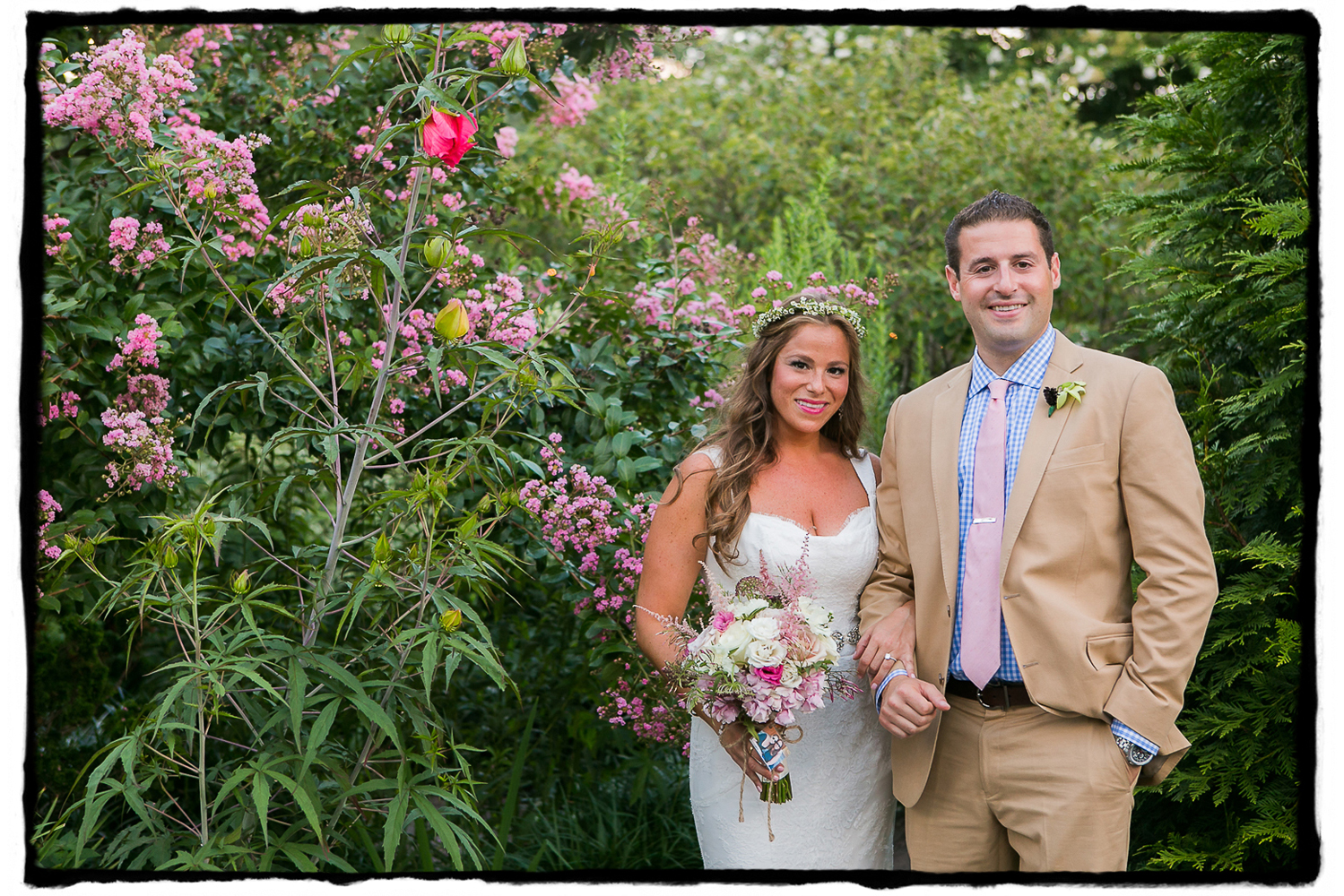 Rorie & Adam's beautiful summer wedding at The Palm House featured shades of pink and a huge wedding party and had a garden party style.  The groom and his groomsmen wore these charming tan suits with a blue checked shirt and pink ties!