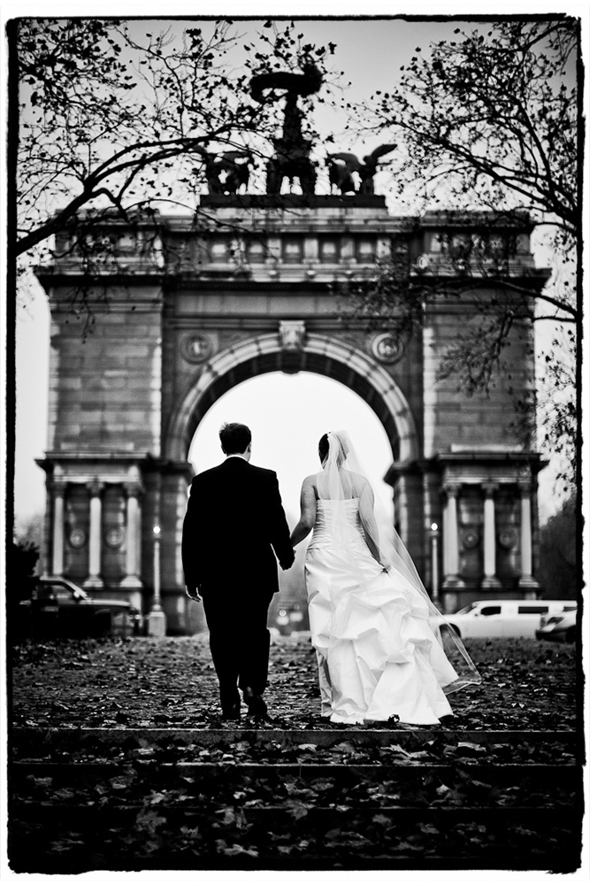 We stopped on the way from the church to the Prospect Park Picnic house for some pictures with the Arch at Grand Army Plaza.  They're shown here walking back to their limo.  I loved it in color with the fall leaves, but in black and white it looks so majestic, don't you think?