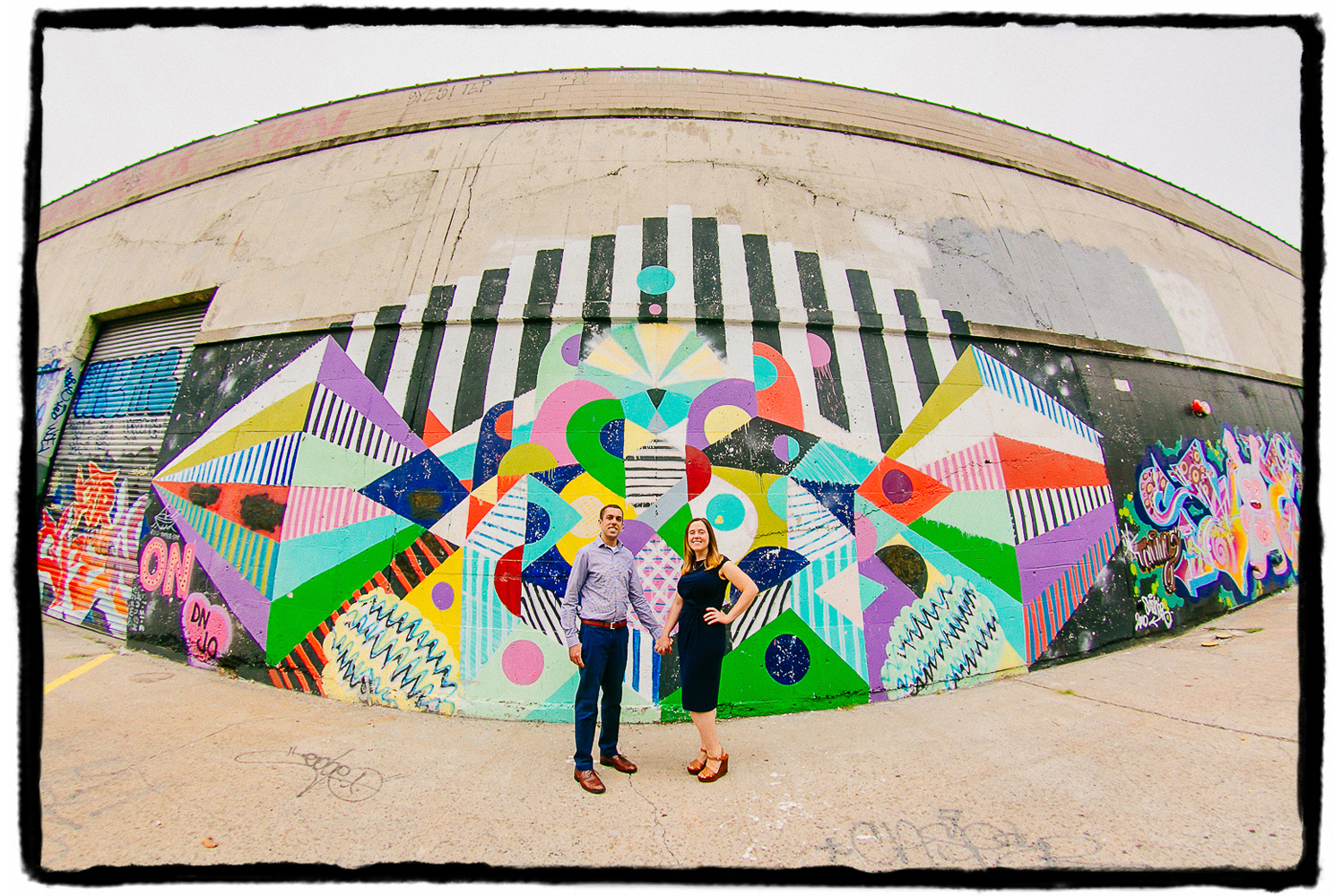Engagement Portrait: Jessie & Steve let me immortalize them through a fisheye lens with the street art in Greenpoint, Brooklyn.
